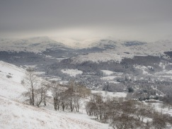 Ambleside in the valley with Wetherlam in the distance seen from the Wansfell ascent