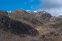 Scafell summit. Scafell Crag falling away to it's right towards Mickledore, Cam Spout falls at the bottom right