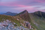 Moel Hebog, left, Mynydd Drws-y-Coed centre and Trum y Ddysgl right in the afterglow after sunset.