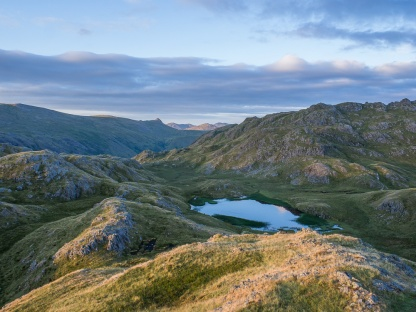 Tarn at Leaves at sunrise, Wetherlam lit up in the distance