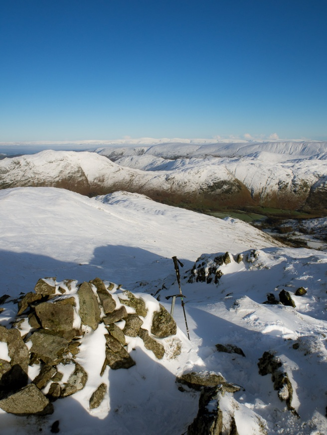 View from the summit eastwards with the white line of the pennines on the horizon.